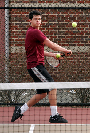 Gloucester: Gloucester's Chase Kelly returns the ball during their match against Beverly yesterday. Photo by Kate Glass/Gloucester Daily Times
