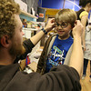 Gloucester: David Brooks of Cape Ann Art Haven fits Harry Potter glasses on Shea Verga during Harry Potter Day earlier this week. Photo by Kate Glass/Gloucester Daily Times