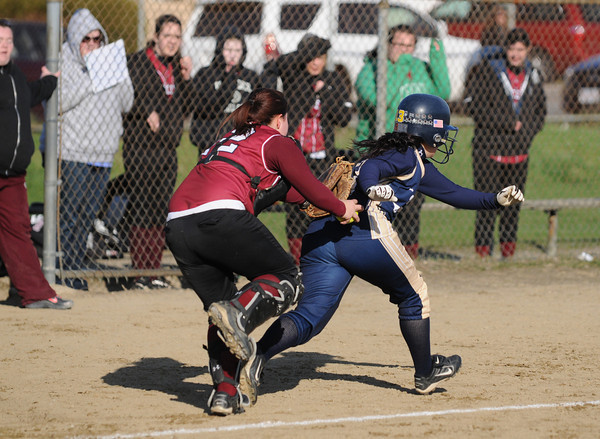 Gloucester: T Francis puts the tag on Winthrop's Andrea Martucci, as she was caught in a run down coming home, at Burnhans Feild Friday afternoon. Desi Smith/Gloucester Daily Times. April 15,2011.