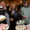 Gloucester: John Randazza, Joanne Randazza and Joan Chabot sample mini cupcakes from West End Sweets during the Taste of Cape Ann, which was held at Cruiseport on March 23rd. The event was a fundraiser for The Open Door and Cape Ann Animal Aid. Photo by Kate Glass/Gloucester Daily Times