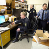 Essex Police Officers Nick Hamilton, Alex Edwards, and Rob Gilardi work in the Essex Police Station during a shift change yesterday. Essex Police are hoping to purchase a modular storage unit that would be used for temporary office space and storage. Photo by Kate Glass/Gloucester Daily Times