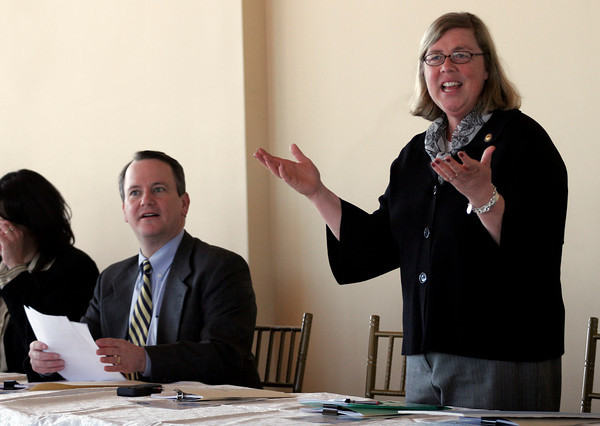 Gloucester: Mayor Carolyn Kirk, standing next to Lt. Gov. Tim Murray, welcomes the Seaport Advisory Council to Gloucester for their meeting, which was held at Cruiseport yesterday. The council approved a grant for $700,000 for the Harborwalk project. Photo by Kate Glass/Gloucester Daily Times