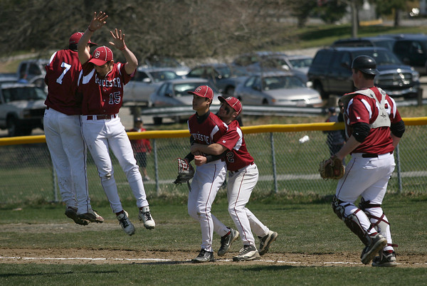 Gloucester: Gloucester's Caulin Rogers and Santo Parisi leap in the air to celebrate their 11-0 victory over Marblehead as Joey Avila prepares to lift pitcher Matt Catarino, who pitched 7 innings of shut-out baseball in the win at Nate Ross Field yesterday morning. Pictured at right is catcher Mike Muniz. Photo by Kate Glass/Gloucester Daily Times