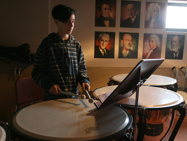 Rockport: Ben Nelson plays timpani with the Rockport Middle School 7-8th Grade Band during their rehearsal yesterday morning. The middle school bands performed for their families during a special concert in the band room last night to make up for a concert that was postponed a few weeks ago. Photo by Kate Glass/Gloucester Daily Times