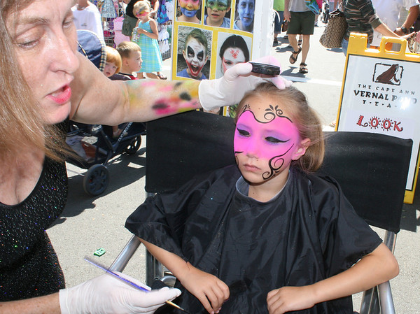 Gloucester: Gayle Rosen paints a mask on Brianna Alves, 7, at Gloucester Sidewalk Days on Saturday afternoon. <br /> Photo by Silvie Lockerova/Gloucester Daily Times