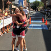 Nan Gorton Demaso and Marnie Lawler of Hilltop Training in Manchester hug each other after finishing seconds apart in the 1st Gloucester Triathlon. Photo by Desi Smith/Gloucester Daily Times
