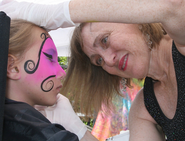Gloucester: Gayle Rosen paints a mask on Brianna Alves, 7, at Gloucester Sidewalk Days on Saturday. <br /> Photo by Silvie Lockerova/Gloucester Daily Times