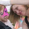Gloucester: Gayle Rosen paints a mask on Brianna Alves, 7, at Gloucester Sidewalk Days on Saturday. <br /> Photo by Silvie Lockerova/Gloucester Daily Times