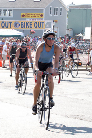 Competitors mount their bikes and head out onto the course for the 1st Gloucester Triathlon held Sunday morning. Photo by Desi Smith/Gloucester Daily Times