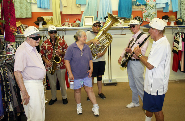 Gloucester: Cape Ann Jazz Band  and Judith Sudduth, middle, inside of The Dress Code at Gloucester Sidewalk Days on Saturday morning. Don Trasher, right, Mark French, John Evans, Robert Landon and Frank Higgins, left, play Happy Birthday song for Sudduth, who just celebrated sixty nine years of life. <br /> Photo by Silvie Lockerova/Gloucester Daily Times