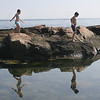 Magnolia: Madison Bourbon, 7, and her brother Cole, 11, look for crabs behind Shore Road.<br /> Silvie Lockerova/Gloucester Daily Times