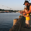 Gloucester: Salvatore Russo of Gloucester fishes with his grandfather, Salvatore Russo at the Jodrey State Fish Pier on Tuesday evening. Photo by Kate Glass/Gloucester Daily Times Tuesday, August 25, 2009