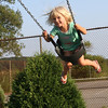 Essex: Pippa Spingler, 3, of Essex swings at the Memorial Park playground Tuesday evening. Photo by Kate Glass/Gloucester Daily Times Wednesday, August 25, 2009