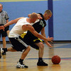 Gloucester: Flynn Physical Therapy's Ryan Flynn dribbles past Gloucester Dispatch's Mark Oliver during their game in the Cape Ann YMCA's Summer Basketball League last night. Flynn won the game 99-97. Photo by Kate Glass/Gloucester Daily Times