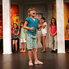 Gloucester: Sara Wheeler, 8, performs an impersonation allowing the audience to guess who she is ipretending to be during the open class for parents as the Gloucester Stage Youth Acting Workshop raps up for the summer at the Gloucester Stage Company Friday. Sara was doing an impression of her director Heidi Dallin who runs the acting workshops. Mary Muckenhoupt/Gloucester Daily Times