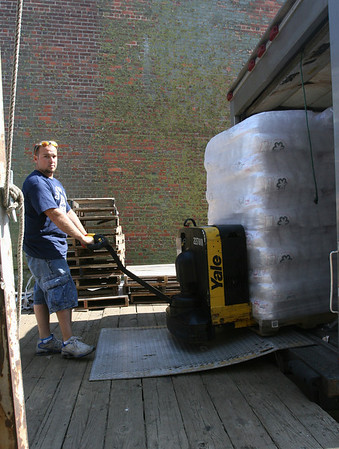 Gloucester: Matt O'Brien unloads a pallet of ice at Cape Pond Ice yesterday afternoon. The company has cut production to reduce water use during Gloucester's water crisis, but has enough inventory to get by. Photo by Kate Glass/Gloucester Daily Times Wednesday, August 19, 2009