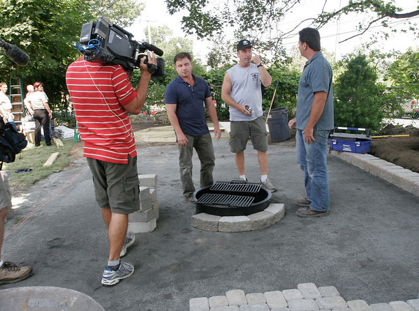 Gloucester: Andy Hillstrand of The Deadliest Catch's Time Bandit, jokes with Indoors Out co-hosts Derek Stearns, left, and Dean Marsico, right, as they redo the Gloucester backyard of Jamie Marshall. Photo by Kate Glass/Gloucester Daily Times Tuesday, August 4, 2009