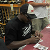 Gloucester: Troy Brown, the Former New England Patriots all-time leading receiver, who is now a part-owner of Narragansett Beer, signs two Patriots tickets to be raffled of at the Liquior Locker Saturday afternoon. Desi Smith Photo/Gloucester Daily Times. August 16,2009.