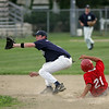 Rockport: Manchester Mariners' Whit Graham reaches for the ball as Rockport Townies' Mike Bertolino steals second base during the second game of the Intertown League Championship last night. Photo by Kate Glass/Gloucester Daily Times Monday, August 10, 2009