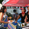 Rockport: Daphne Ped Congeosi and Mary Anne Whited, right, serve wine for Stephanie Smith, left, at the Lobsterfest on Saturday morning.<br /> Silvie Lockerova/Gloucester Daily Times