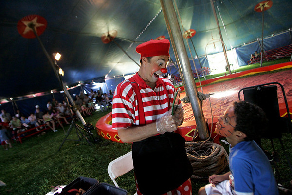 Rockport: Olex the Clown shows David Avila, 7, of Rockport his new tiger face at the Vidbel Circus behind Rockport Elementary School Saturday afternoon.  Olex Kartukov provided face painting for the kids before the show began and during intermission. Mary Muckenhoupt/Gloucester Daily Times