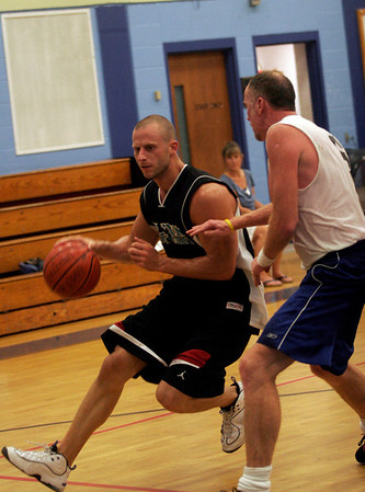 Gloucester: Flynn Physical Therapy's Dave Stantial dribbles past Gloucester Dispatch's Todd Newton during their game in the Cape Ann YMCA's Summer Basketball League last night. Flynn won the game 99-97. Photo by Kate Glass/Gloucester Daily Times