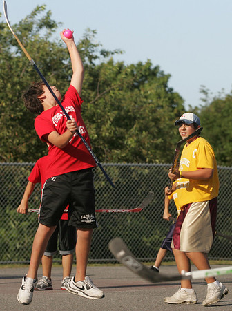 Gloucester: Owen Parisi leaps for a high ball as Anthony Ciaramitaro looks on during the last regular season game in the Young Legends Street Hockey League at Stage Fort Park last night. Photo by Kate Glass/Gloucester Daily Times Friday, August 7, 2009