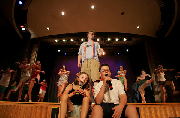 "Gloucester: Cara Stockman, 11,  and Aaron Graham, 12, sings a song with Ryan Hull, back, while rehearsing for ""Godspell"" at O'Maley Middle School Wednesday afternoon. The summer camp production will be performed today at the O'Maley school at noon. Mary Muckenhoupt/Gloucester Daily Times"