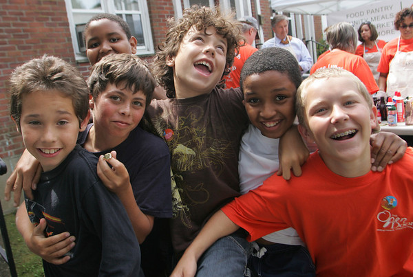 Gloucester: From left, Richy B. Haight, John Salvi-Souza, Jonathan Mola, back, Mark Smith, Johan Mola, and Peter Periera pose for a picture at the Open Door Summer Lunch Program at Riverdale Park Friday afternoon. Mary Muckenhoupt/Gloucester Daily Times