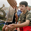 Essex: Cody Corelli, 8, gets an up close view of a Timber Rattlesnake while sitting in the front row next to his sister Skyler, 4, as Rick Roth presents Snake of Massachusetts and the world out behind TOHP Burnham Library in Essex Thursday evening. The Timber Rattlesnake is one of two venomous snakes that can be found in Massachusetts. Mary Muckenhoupt/Gloucester Daily Times