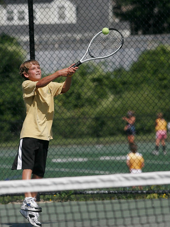 Manchester: Winston Feuerbach leaps to make contact with the ball during tennis lessons at the Brook Street Courts on Wednesday afternoon. Photo by Kate Glass/Gloucester Daily Times
