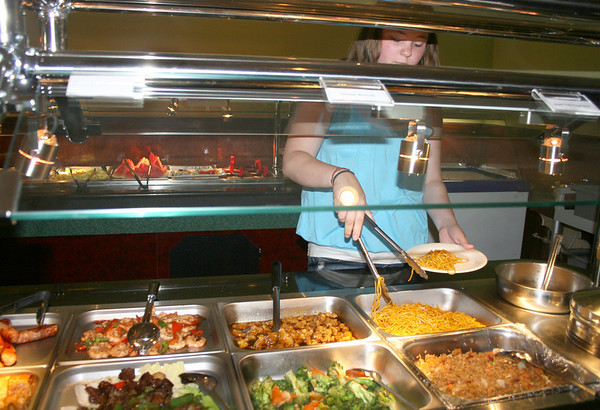 Gloucester: Cathleen Neel at No.1. China Buffet, goes for a lunch buffet on Monday morning. Yama Wok reopened as No.1. China Buffet on August 5th, expanded their space for sitdown dining and they offer variety of meals. <br /> Silvie Lockerova/Gloucester Daily Times