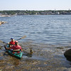 Local kayakers, Bill O'Maley and June Catalina set out for an afternoon on the water from Old Granite Pier in Rockport yesterday. Photo by Maria Uminski/ Gloucester Daily Times