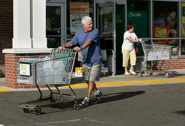 Gloucester: Joe Briguglio of Gloucester leaves Shaws on Railroad Avenue with a cart filled with bottled water after the city declared the drinking water not safe to drink.  Resdients are asked to boil tap water before using it. Mary Muckenhoupt/Gloucester Daily Times