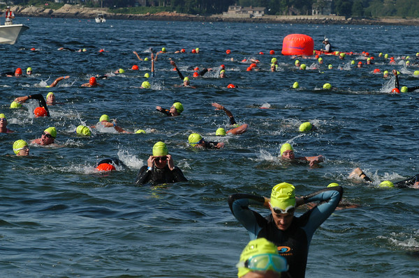 Hundreds of competitors head back to the beach after their swim during the 1st Gloucester Triathlon held Sunday morning on Pavilion Beach. Photo by Desi Smith/Gloucester Daily Times