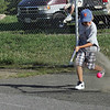Gloucester: Stephen Curcuru digs the ball out of the dirt while waiting for the second half of his game in the Young Legends Street Hockey League at Stage Fort Park on Friday night. Photo by Kate Glass/Gloucester Daily Times Friday, August 7, 2009