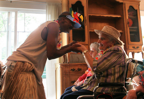 Mike Gifford, activities assistant at Golden Living Center in Gloucester, dances with resident Lillian Fraga during Golden Living's Luau yesterday. The pair danced to the musical stylings of Al Mitchell's Black and White Band. Photo by Maria Uminski/ Gloucester Daily Times