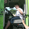 Gloucester: Bo Bedrosian, 12, gets to sit behind the wheel of the Shaw's delivery truck after it dropped off a load of water at Gloucester High School on Monday. Photo by Kate Glass/Gloucester Daily Times Monday, August 31, 2009