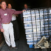 Gloucester: Joe D'Angelo, left, of the Railroad Ave. Shaws, Bob Serra, center, and Kevin Bacon, right, both of the Eastern Ave. Shaws, help unload pallets of water at Gloucester High School to be distributed throughout Gloucester Schools during the water crisis. Shaws is donating 17,000 bottles of water to the schools. Photo by Kate Glass/Gloucester Daily Times Monday, August 31, 2009