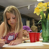 Sofie, 7,left, and Rosie, 7, right, both of Rockport, are hard at work on their drawings during a Drawing and Painting Session with Becky Merry at the Rockport Art Association yesterday. Photo by Maria Uminski/ Gloucester Daily Times