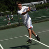 Manchester: Jonathan Browning returns the ball during tennis lessons at the Brook Street Tennis Courts yesterday afternoon. The lessons, which are run through the Manchester Parks & Recreation Department, end this week. Photo by Kate Glass/Gloucester Daily Times Wednesday, August 19, 2009