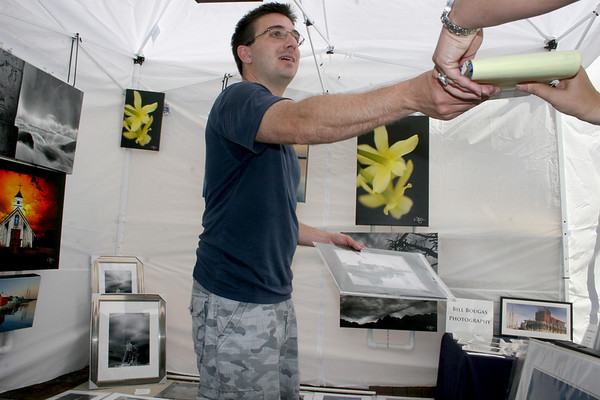 Gloucester: Bill Bougas sells his art photography at Gloucester Sidewalk Days on Saturday. <br /> Photo by Silvie Lockerova/Gloucester Daily Times