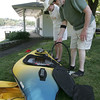 Manchester: Ami Silvestre and Dennis Kelly pump up one of their inflatable kayaks at Tuck's Point on Tuesday afternoon. The two were planning to kayak around the harbor. Photo by Kate Glass/Gloucester Daily Times Tuesday, August 11, 2009