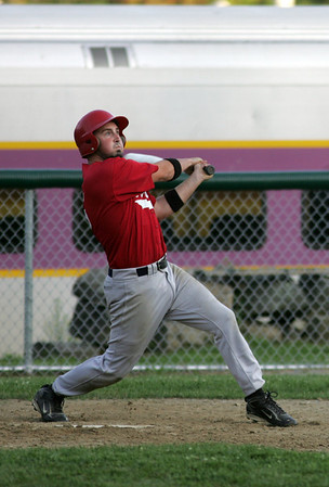 Rockport: Rockport Townies' Chris Bouchie watches as the ball goes into the woods for a double to drive in two runs against the Manchester Mariners during the second game of the Intertown League Championship last night. Photo by Kate Glass/Gloucester Daily Times Monday, August 10, 2009