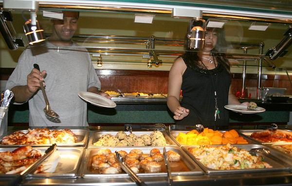 Gloucester: Sam Reinoso and Shannon Seigas selfserve a lunch on Monday morning at No.1. China Buffet. Yama Wok reopened as No.1. China Buffet on August 5th, expanded their space for sitdown dining and they offer variety of meals. <br /> Silvie Lockerova/Gloucester Daily Times