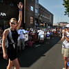 Alicia Kaye of Maynard waves to the crowd after winning the 1st Gloucester Triathlon held Sunday morning. Photo by Desi Smith/Gloucester Daily Times