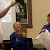 Manchester: Haley New, 9, and Gray Morrison, 11, watch as aerospace educator Gary Pozzato teaches a lesson about gravity using water during a program sponsored by Friends of the Manchester Library yesterday morning. Photo by Kate Glass/Gloucester Daily Times Wednesday, August 12, 2009
