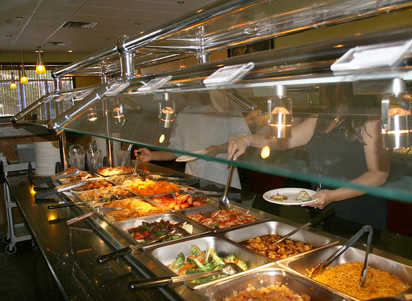 Gloucester: Custommers at No.1. China Buffet, getting a lunch on Monday morning. Yama Wok reopened as No.1. China Buffet on August 5th, expanded their space for sitdown dining and they offer variety of meals. <br /> Silvie Lockerova/Gloucester Daily Times