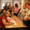 Anita Sanchez signs a book for Susan Hardy of Rockport after her presentation about her new childrens book, The Invasion of Sandy Beach. Hardy, who teaches at the Essex Elementary School, bought the book for the library there. Photo by Maria Uminski/ Gloucester Daily Times