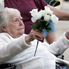 "Rockport: Naomi Gilpatrick waves a bouquet of flowers to the tune of ""God Bless America"" at the Den-Mar Rehab and Nursing Center's annual antique car show on Tuesday evening. The event featured cars, food, and music by Al LaBella. Photo by Kate Glass/Gloucester Daily Times Tuesday, August 18, 2009"